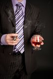 Businessman with glass of cognac and good cigar Stock Photo
