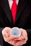 Businessman with a glass globe Royalty Free Stock Image