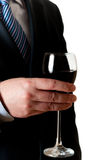 Businessman with glass of wine Royalty Free Stock Image