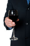Businessman with glass of wine Royalty Free Stock Photos