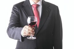 Businessman with glass of wine. Successful business man with wine glass Royalty Free Stock Photography