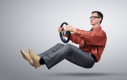 Businessman in glasses car driver with a steering wheel Stock Images