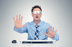 Businessman with glasses of foil in front of computer. Royalty Free Stock Photography