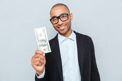 Businessman in glasses holding dollar banknote Royalty Free Stock Images