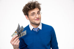 Businessman in glasses holding money Stock Photo