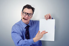 Businessman in glasses holding a paper. Stock Images