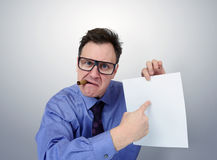 Businessman in glasses holding a paper. Stock Photo