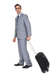 Businessman with glasses holding a trolley Royalty Free Stock Image