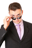 Businessman with glasses looks askance Stock Photography