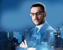 Businessman in glasses over night singapore city. Business, people and corporate concept - businessman in glasses over night singapore city skyscrapers Royalty Free Stock Image
