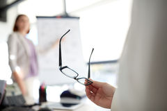 Businessman with glasses at presentation in office Royalty Free Stock Images