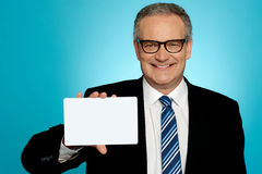 Businessman in glasses showing placard Stock Image