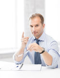 Businessman with glasses showing warning gesture Stock Photos