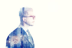 Businessman with glasses side view and blue city Stock Images