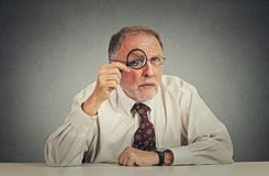 Businessman with glasses skeptically looking at you Stock Images