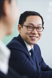 Businessman with glasses Smiling at Colleague Stock Photography
