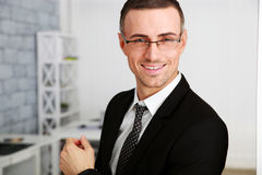 Businessman in glasses standing Stock Images