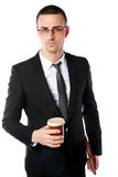 Businessman in glasses standing with cup of coffee Stock Photo