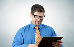 Businessman in glasses with the tablet Royalty Free Stock Image