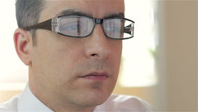 Businessman with glasses working on computer - closeup stock footage