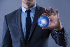 The businessman in globalisation global business concept. Businessman in globalisation global business concept stock images