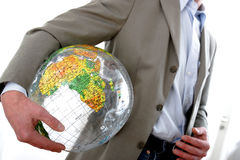 Businessman with globe. Businessman in motion holding a globe royalty free stock photography
