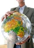 Businessman with globe. Businessman holding a globe, international work stock photo