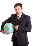 Businessman with globe Stock Images