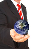 Businessman with globe. Mini world on businessman's hands, shallow dof, map used: copyright statement stock photos
