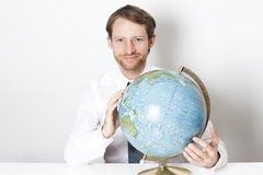 Businessman with a globe Stock Photo