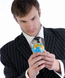 Businessman and globe Royalty Free Stock Image