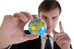Businessman and globe Stock Image