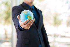 Businessman with a globe Stock Image