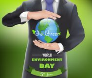 Businessman with a globe of concept world environment day Stock Image
