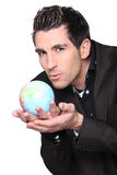 Businessman with globe in his hands Royalty Free Stock Images