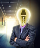 Businessman with glowing bulb instead of the head royalty free stock photo