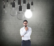 Businessman with glowing light bulb Royalty Free Stock Photos