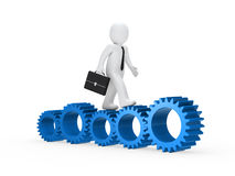 Businessman go on blue gear Royalty Free Stock Images