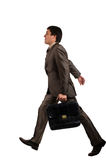 Businessman go to work. With a briefcase isolated over white background Royalty Free Stock Image