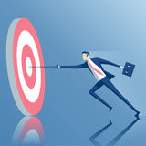 Businessman and goal. Businessman with a rapier hits the center of the target, the employee runs with a sword to the target, business concept success and goal Royalty Free Stock Images