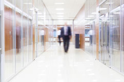 Businessman goes along a corridor Royalty Free Stock Image