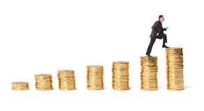 Businessman goes up the gold coins Royalty Free Stock Images