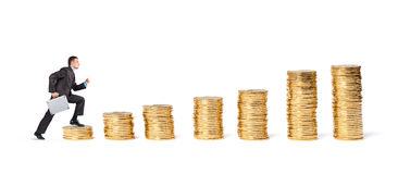 Businessman goes up the gold coins Stock Image