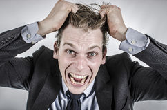 Businessman going crazy Royalty Free Stock Photo