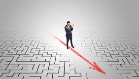 Businessman going through the maze stock images