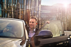 Businessman going out of the car Stock Photography
