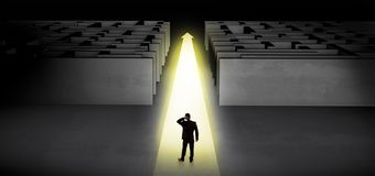 Businessman going straight ahead between two mazes stock illustration