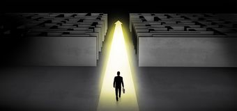Businessman going straight ahead between two mazes stock photography