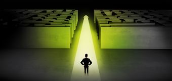 Businessman going straight ahead between two mazes. Businessman going straight ahead on a lighted carpet arrow between two maze stock photography
