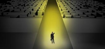 Businessman going straight on two dark mazes stock photos